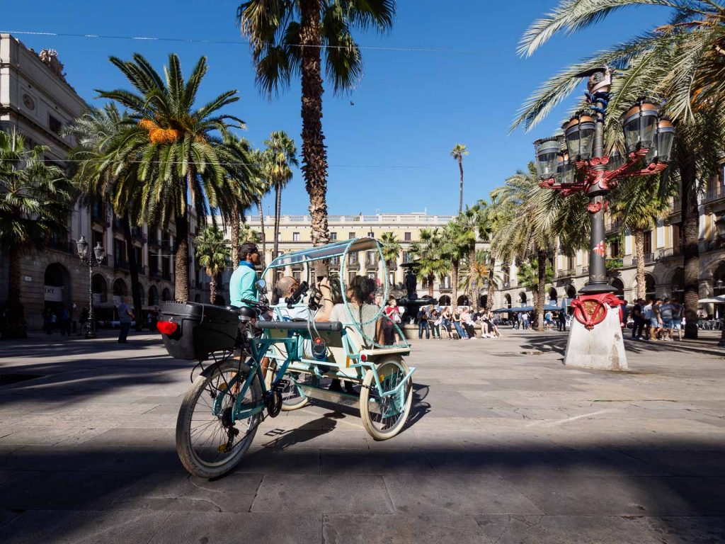 Tourists in a trike looking at Plaça Reial (Royal Square) in Barcelona