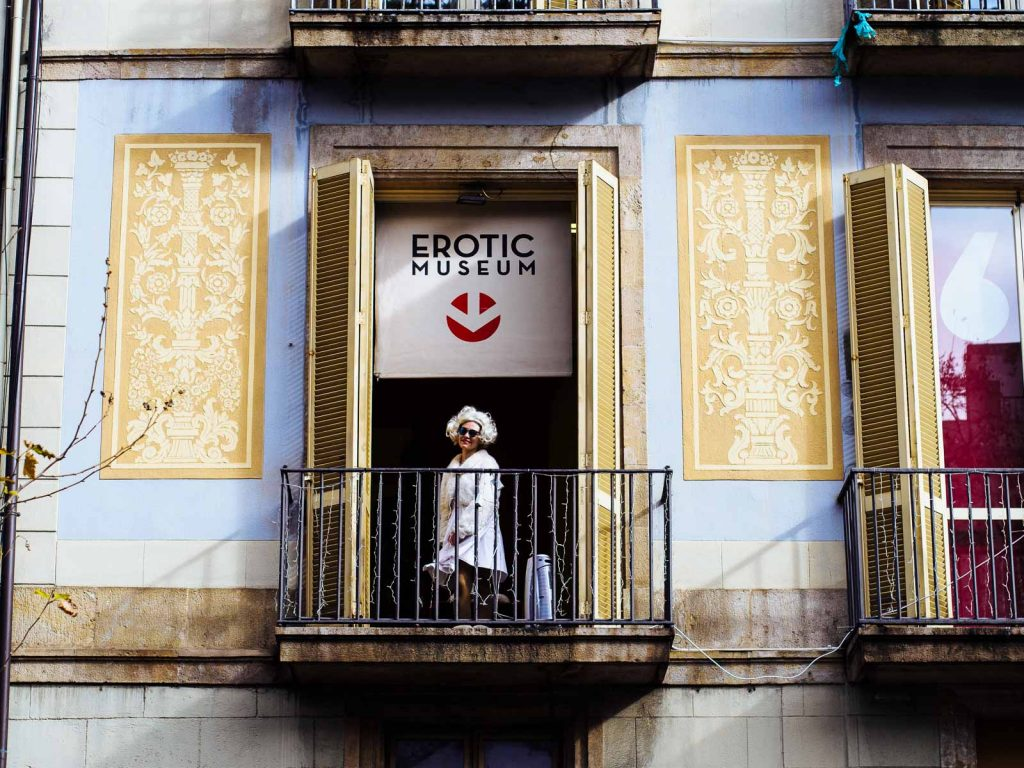 An impersonator of Marilyn plays her role from the balcony of the Erotic Museum at Las Ramblas in Barcelona