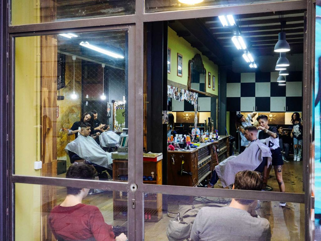 Hairdressing with a modern look in the old neighbourhood el Raval, in Barcelona