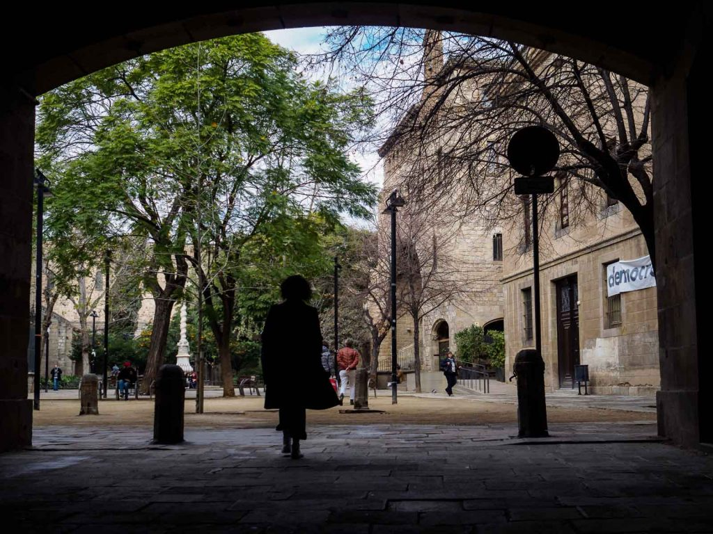 Silhouette of a misterious woman entering the garden of the Catalonia Library in Barcelona