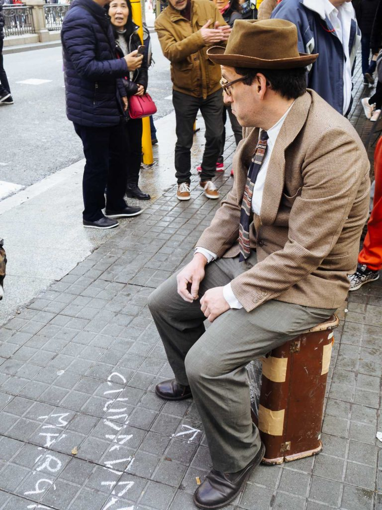 A mimic demonstrator against the touristic model of the city of Barcelona, playing as a Marginated Citizen